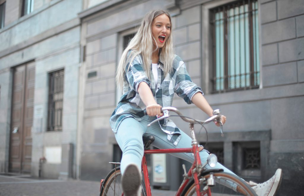 woman riding bike enthusiastically scaled