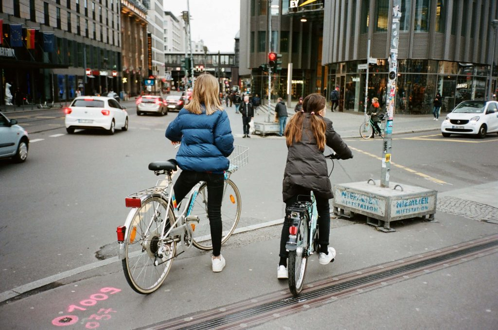 women riding bicycles scaled